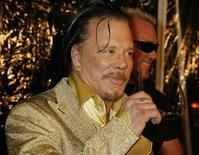 "<p>Mickey Rourke, star of the film ""The Wrestler,"" poses at the film's Los Angeles premiere in Beverly Hills December 16, 2008. REUTERS/Fred Prouser</p>"