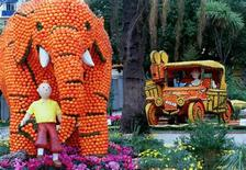 """<p>Models representing the famous Belgian cartoon character Tintin from his """"Adventures in the Congo"""" are posed among exhibits made from oranges and lemons at the 65th annual Lemon Festival in the Southern French town of Menton February 14,1998. REUTERS/Jacques Munch</p>"""