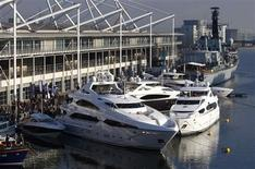 <p>Luxury cruisers are moored outside the London International Boat Show January 9, 2009 REUTERS/ Eddie Keogh</p>