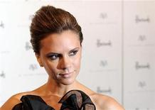 <p>Singer and clothes designer Victoria Beckham poses for photographers during a photocall at Harrods store, to promote the Spring/Summer 2008 collection of her 'dVb' clothing range, London May 15, 2008. REUTERS/Toby Melville</p>
