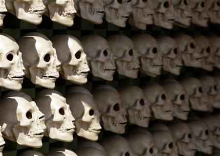 An installation of skulls is seen in a theatre where artists assembled an altar for the Dead in Mexico City's Zocalo main square, near the presidential palace October 29, 2008. REUTERS/Henry Romero
