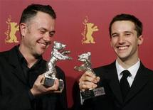 <p>Directors Michael Winterbottom (L) and Mat Whitecross pose with their Silver Berlin Bears after the awarding ceremony at the 56th Berlinale International Film Festival in Berlin February 18, 2006. REUTERS/Arnd Wiegmann</p>