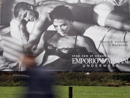 A maxi advertising campaign for Armani underwear with British soccer player David Beckham and his wife Victoria is pictured in downtown Milan January 20, 2009. REUTERS/Alessandro Garofalo