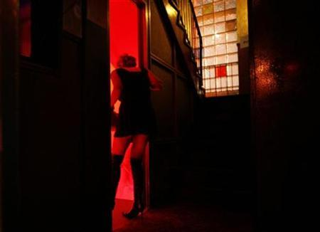 A prostitute says goodbye to a guest at the infamous brothel 'Hotel Luxor' at the Reeperbahn red-light district in Hamburg March 18, 2008. REUTERS/Christian Charisius