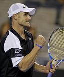 <p>Americano Roddick comemora vitória sobre belga Malisse no Aberto da Austrália em Melbourne. REUTERS/Petar Kujundzic</p>