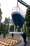 "<p>Part of the bow of the former ""France"" ocean liner is lifted by crane into the courtyard of Artcurial auction house in Paris, January 23, 2009. REUTERS/Philippe Wojazer</p>"