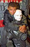 "<p>British actor Craig Charles, who played Dave Lister in the TV series ""Red Dwarf"", hugs a model of Kryton, another character from the TV series in London June 5, 1995. REUTERS/Andrew Wong</p>"