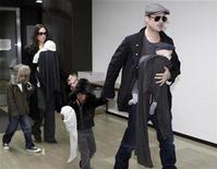 <p>U.S. actors Brad Pitt and Angelina Jolie arrive with their children at Narita airport, near Tokyo, January 27, 2009. From L-R: Maddox, Vivienne Marcheline (carried by Jolie), Shiloh, Zahara and Knox Leon (carried by Pitt). REUTERS/Toru Hanai</p>