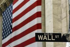 <p>A street sign is seen in front of an American flag hanging on the front of the New York Stock Exchange August 9, 2007. REUTERS/Lucas Jackson</p>