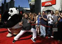 "<p>Cast member Jack Black poses with a panda character during the DVD release of ""Kung Fu Panda"" at the Grauman's Chinese theatre in Hollywood, California November 9, 2008. REUTERS/Mario Anzuoni</p>"