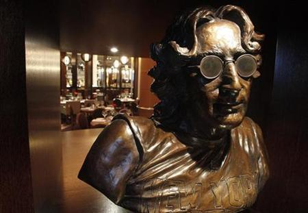A bust of Beatle John Lennon is placed the reception area at the newly opened Hard Days Night Hotel in Liverpool, northern England February 1, 2008. REUTERS/Phil Noble