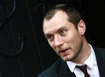 <p>Actor Jude Law leaves St Thomas Church after the thanksgiving service for the life of film director Anthony Minghella in Newport on the Isle of Wight in this file photo from April 26, 2008. REUTERS/Luke MacGregor</p>