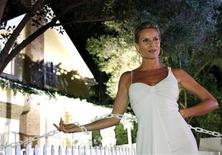 <p>Cast member Nicollette Sheridan poses on 'Wisteria Lane' in front of the house where her character lives, at the party for the DVD release of 'Desperate Housewives: The Complete Second Season: Extra Juicy Edition' in Universal City, California, August 5, 2006. REUTERS/Mario Anzuoni</p>