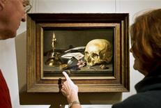 <p>Visitors look at painter Pieter Claesz's Vanitas still life in the Frans Hals Museum in Haarlem in this picture taken January 29, 2009. REUTERS/Robin van Lonkhuijsen/United Photos</p>