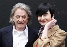 <p>British fashion designer Paul Smith and model Erin O'Connor pose for photographers during a photocall to promote the 25th anniversary of London Fashion Week, in London February 18, 2009. REUTERS/Stephen Hird</p>