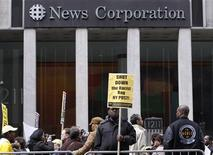 <p>Protesters march outside the News Corp. headquarters in New York February 19, 2009. REUTERS/Brendan McDermid</p>