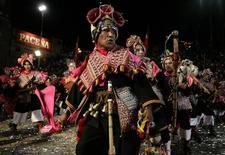 """<p>Members of """"Pujllay"""" group perform during the Carnival parade in Oruro, some 200 km (124 miles) south of La Paz, February 21, 2009. REUTERS/David Mercado</p>"""