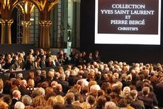<p>People take part in a Christie's auction of the private art collection of late French fashion designer Yves Saint Laurent at the Grand Palais museum on the Champs Elysees in Paris February 23, 2009. REUTERS/Regis Duvignau</p>