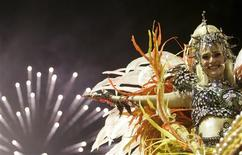 <p>A reveller of Portela samba school dances atop a float during the second night of the Carnival parade in Rio de Janeiro's Sambadrome, early February 24, 2009. REUTERS/Bruno Domingos</p>