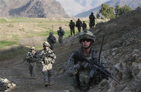 U.S. soldiers with Alpha Company, 32nd Infantry Regiment walk in a line during a patrol at Mullagora village, close to the border with Pakistan in Kunar Province, February 24, 2009. REUTERS/Oleg Popov