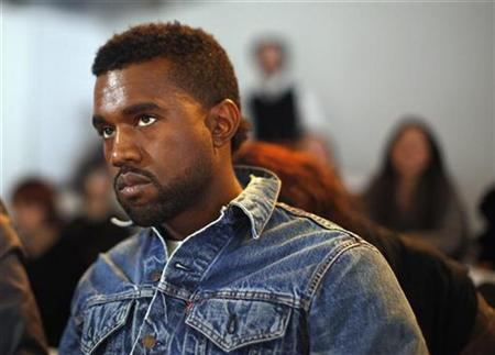 Musician Kanye West poses for photographers before the Preen by Thornton Bregazzi Fall 2009 collection during New York Fashion Week in New York February 15, 2009. REUTERS/Eric Thayer