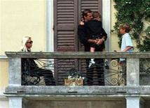 <p>Donatella Versace (L), sister of Slain fashion king Gianni Versace, sits on the balcony of Versace's villa on Lake Como along with unidentified family members after arriving from Miami in this file photo from July 18, 1997.</p>