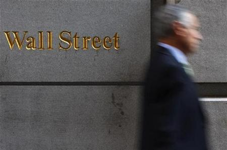 A man walks along Wall Street in New York September 18, 2008. REUTERS/Eric Thayer
