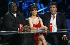 "<p>American Idol judges (from L-R) Randy Jackson, Paula Abdul and Simon Cowell sit at the ""Idol Gives Back"" show at the Kodak theatre in Hollywood, California April 6, 2008. REUTERS/Mario Anzuoni</p>"