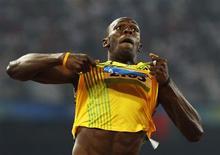 <p>Usain Bolt, campeão olímpico, durante as Olimpíadas de Pequim 2008, terá de quebrar recorde próprio para ser campeão do mundo, disse a Iaaf nesta quarta-feira. REUTERS/Gary Hershorn/Files</p>