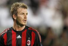 <p>Fabio Capello afirmou que está satisfeito com o fato de David Beckham ficar no Milan até o final da temporada, mas que isso não garante um lugar para o jogador na seleção da Inglaterra. REUTERS/Fadi Al-Assaad (QATAR)</p>