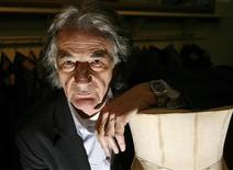 <p>British designer Paul Smith poses for a photo in his office in central London in this February 17, 2009 file photo. Several fashion buyers visiting this month's Paris shows reported a jump in nationalist purchases, especially in London, which before the economic crisis prided itself on being the capital of multicultural style. Photo taken February 17, 2009. REUTERS/Andrew Winning</p>