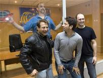 <p>U.S. space tourist Richard Garriott (top) meets his friends (L-R) Peter Diamandis, co-founder and managing director of Space Adventures, Sergey Brin, Google co-founder, and Eric Anderson, CEO of Space Adventures, at Baikonur cosmodrome October 11, 2008. REUTERS/Shamil Zhumatov</p>