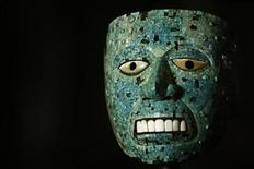 """<p>A turquoise mosaic and cedro wood mask from Mexico is photographed at a launch event for the exhibition """"Moctezuma: Aztec Ruler"""" at the British Museum in London April 7, 2009. REUTERS/Luke MacGregor</p>"""