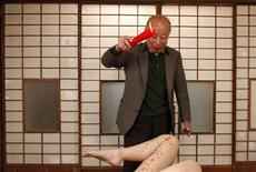 <p>Pornographic movie actor Shigeo Tokuda performs with an actress during the shooting of his latest film in Ichikawa, east of Tokyo, April 13, 2009. Tokuda is Japan's oldest pornographic movie star and is shooting his latest film in which he portrays a master of sex. REUTERS/Toru Hanai</p>