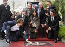 <p>Paul McCartney (L) wipes off the star while posing for pictures with (L-R) Hollywood Chamber of Commerce President and CEO Leron Gubler, Eric Idle, Olivia Harrison, city councilmember Tom LaBonge, Tom Hanks and Dhani Harrison at a ceremony where George Harrison is honored posthumously with a star on the Hollywood Walk of Fame in Los Angeles April 14, 2009. REUTERS/Phil McCarten</p>