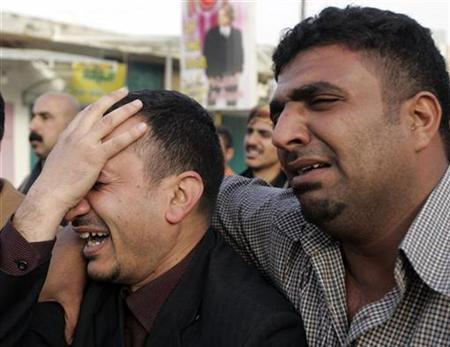 Relatives and colleagues of Al-Baghdadiya television station cameraman Haidar Hashem, who was killed in a bomb attack, grieve during his funeral in Baghdad March 11, 2009. REUTERS/Mohammed Ameen