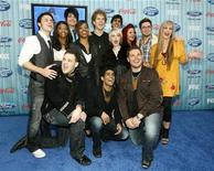 "<p>Performers (L-R) Kris Allen, Jasmine Murray, Matt Giraud, Adam Lambert, Lil Rounds, Scott MacIntyre, Jorge Nunez, Alexis Grace, Anoop Desai, Allison Iraheta, Michael Sarver, Danny Gokey and Megan Corkrey pose at the party for the 12 finalists of the television show ""American Idol"" in Los Angeles March 5, 2009. REUTERS/Mario Anzuoni</p>"