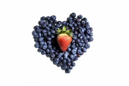 Blueberries and a strawberry shaped like a heart are seen in this undated handout photo. (REUTERS/Newscom)