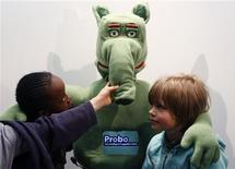 "<p>Children pose with Probo, the ""intelligent huggable"" robot, at the unveiling of the first prototype in Brussels, April 21, 2009. Probo was designed to interact with humans and will assist in providing information and moral support to hospitalized children. REUTERS/Francois Lenoir</p>"