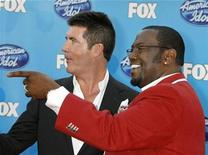 <p>Simon Cowell (L) and Randy Jackson, two of the judges on the American Idol television show arrive for the shows season finale in Los Angeles, California, May 21, 2008. REUTERS/Fred Prouser</p>