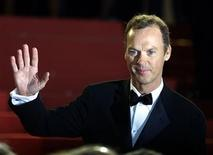 """<p>American actor Michael Keaton waves to the public as he poses for photographers during red carpet arrivals for American director Alexander Payne's film """"About Schmidt"""" in Cannes in this file photo from May 22, 2002. EUTERS/Vincent Kessler VK/</p>"""