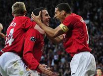 <p>Jogadores do Manchester United comemoram o único gol na vitória sobre o Arsenal pela primeira partida semifinal da Liga dos Campeões nesta quarta-feira. REUTERS/Nigel Roddis</p>