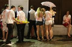 "<p>Revellers queue to enter a night club during a ""Carnage"" event, in Lincoln, eastern England in this file photo from April 27, 2009. REUTERS/Darren Staples</p>"