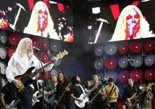 <p>Spinal Tap are joined by Metallica on stage at the Live Earth concert at Wembley Stadium in London, July 7, 2007. REUTERS/Stephen Hird</p>