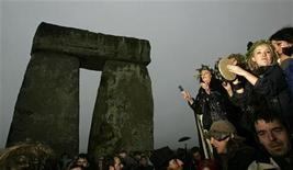 <p>Revellers play instruments during the annual summer solstice at ancient monument, Stonehenge on Salisbury Plain in Wiltshire, southern England June 21, 2008. REUTERS/Luke MacGregor</p>