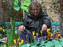 "<p>British television presenter James May poses in his ""Paradise in Plasticine"" garden at the Chelsea Flower Show in London May 17, 2009. REUTERS/Luke MacGregor</p>"
