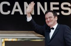 """<p>Director Quentin Tarantino waves as he arrives on the red carpet for the screening of the film """"Vengeance"""" at the 62nd Cannes Film Festival May 17, 2009. REUTERS/Vincent Kessler</p>"""
