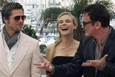 """<p>(R-L) Director Quentin Tarantino poses with cast members Diane Kruger and Brad Pitt during a photocall for the film """"Inglourious Basterds"""" at the 62nd Cannes Film Festival May 20, 2009. REUTERS/Regis Duvignau</p>"""