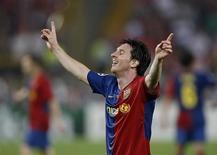 <p>Lionel Messi comemora seu gol pelo Barcelona na vitória de 2 a 0 sobre o Manchester United a garantir o título da Liga dos Campeões em Roma. REUTERS/Albert Gea</p>