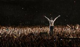 """<p>Dave Gahan of Depeche Mode performs during their concert at Ramat Gan stadium near Tel Aviv May 10, 2009. The concert is part of the band's """"Tour of The Universe 2009"""". REUTERS/Gil Cohen Magen</p>"""